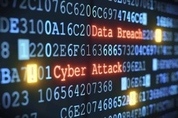 A line of code, which has the words 'Cyber Attack' & 'Data Breach' highlighted in red