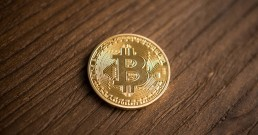 A coin which signifies 'bitcoin'