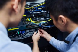 Two men working on a server